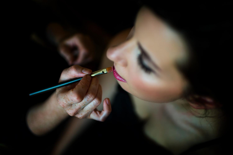 bride putting on lip stick