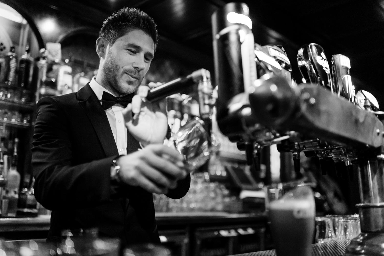 groom pulling pint