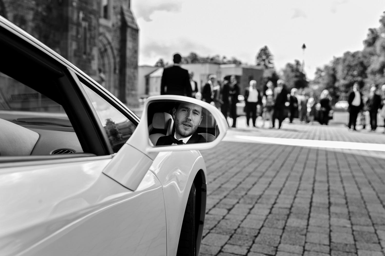 Groom in wedding car