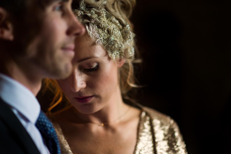 bride and groom in window light