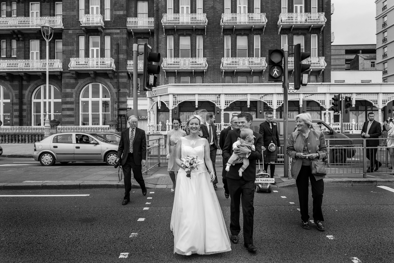 bride and groom walking Brighton streets