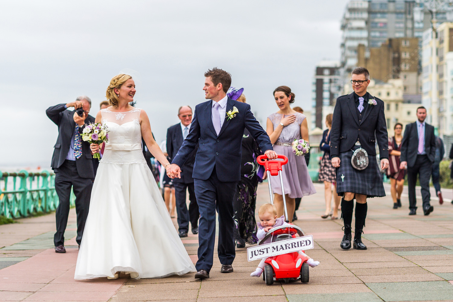 cute photo of bride and groom with daughter