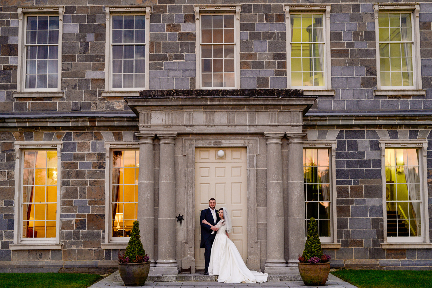 bride and groom outside carton house