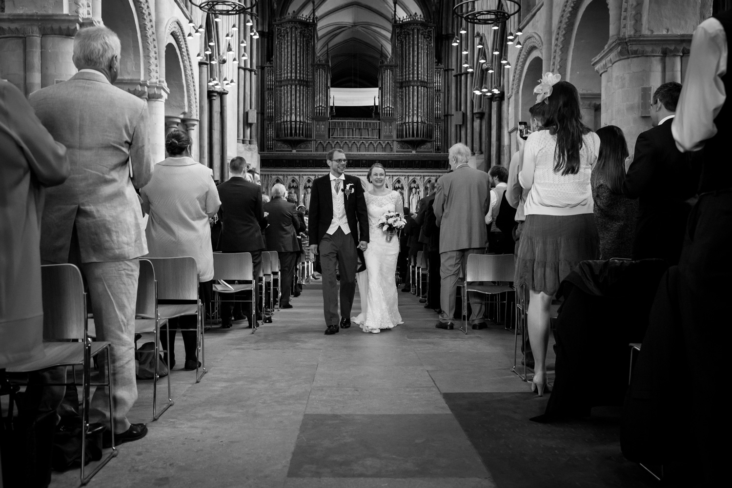 bride and groom leaving Rochester Cathedral
