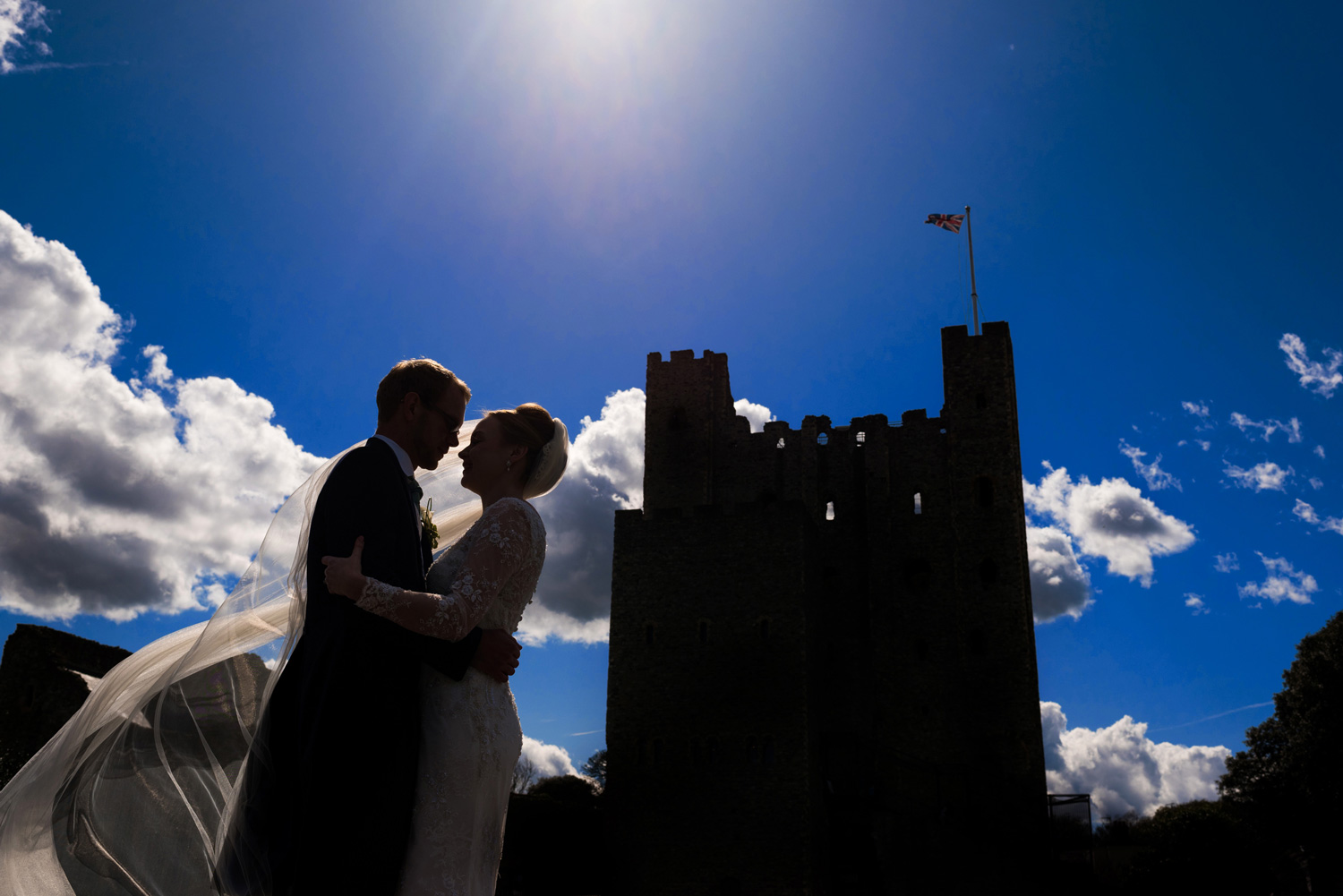 bride and groom in front of Rochester Castle