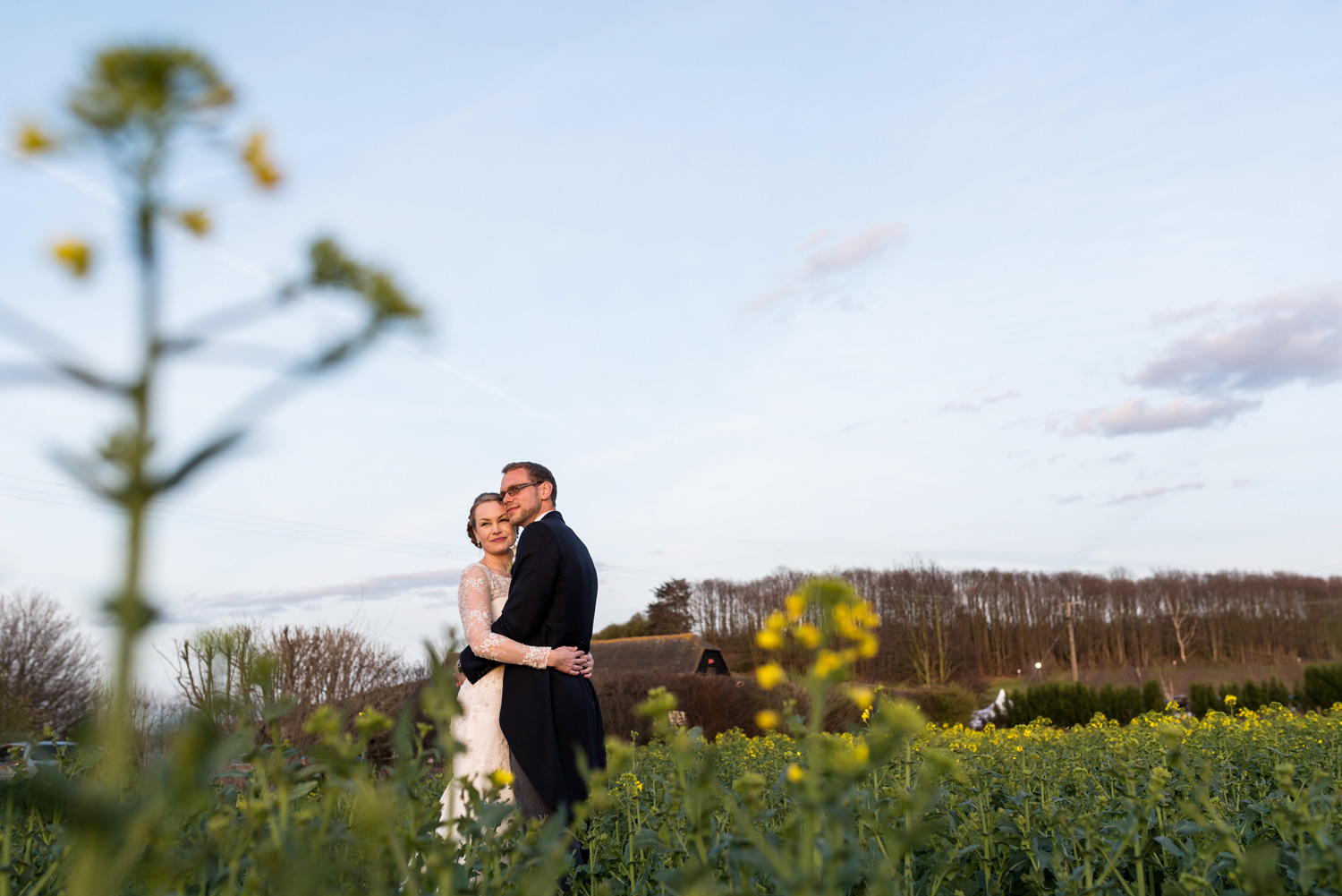 portrait of bride and groom in field