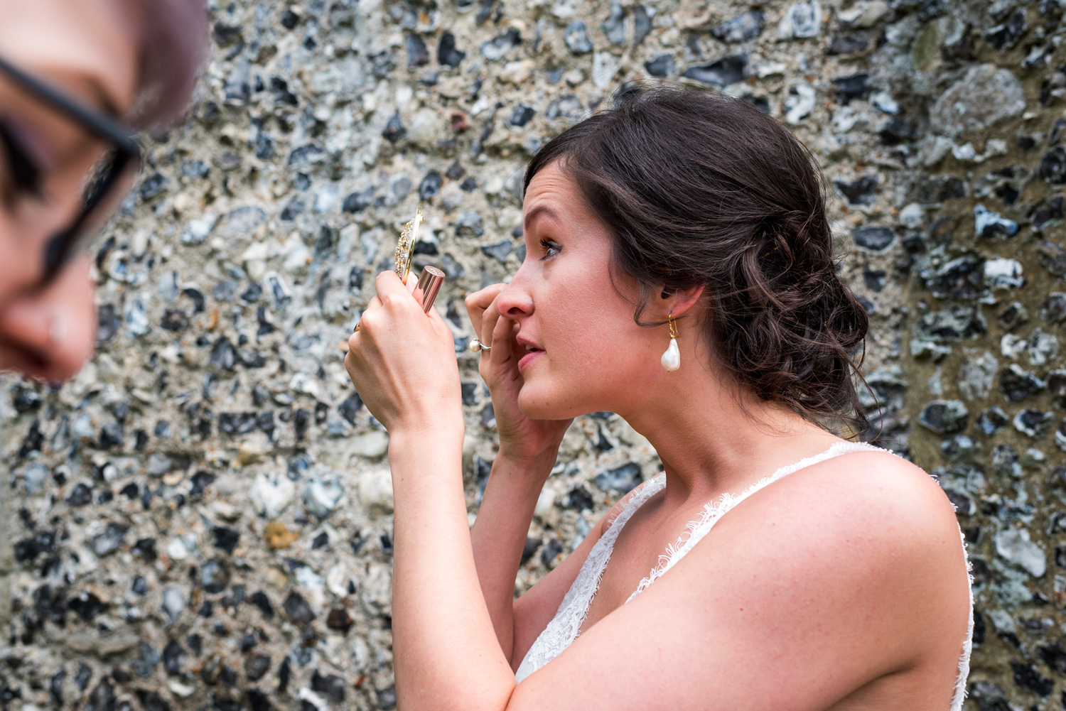 bride checking makeup